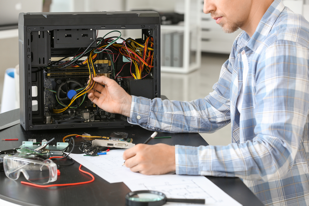 Electronic technician working in service center